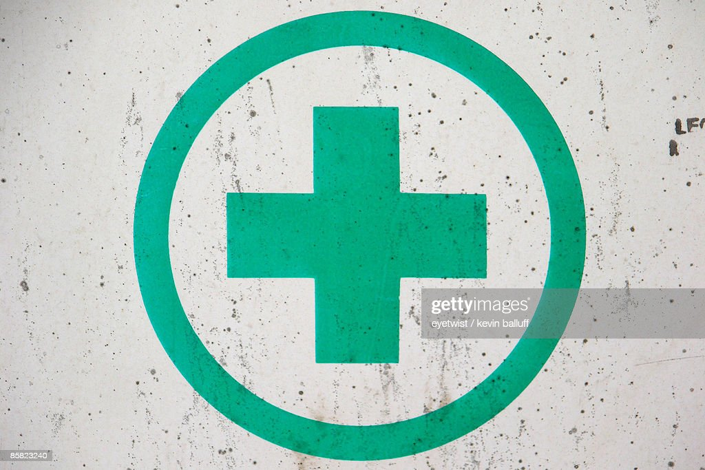 Green cross on a white wall