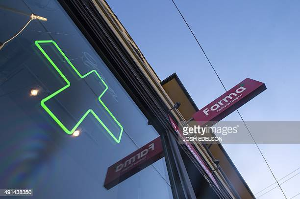 A green cross shines in a window at Farma a marijuana dispensary in Portland Oregon on October 4 2015 As of Oct 1 2015 limited amounts of...