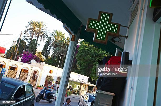 Green cross sign of a pharmacy on July 16 2009 in Rhodes Greece Rhodes is the largest of the Greek Dodecanes Islands