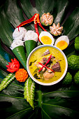 Green curry is typically eaten with rice as part of a wider range of dishes in a meal, or with round rice noodles known as khanom chin as a single dish.A thicker version of green curry made with, for