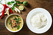 Green curry with shrimp and rice noodles. Thai cuisine. (kang keaw wan)Green curry with shrimp and rice noodles. Thai cuisine. (kang keaw wan)