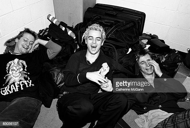 Green Day laugh while posing for a portrait backstage at Madison Square Garden in 1994 in New York City New York
