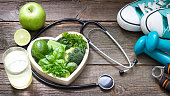 Green diet and sport healthy lifestyle concept with heart