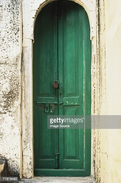 Green door in arch
