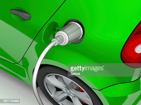 Green electric car being charged