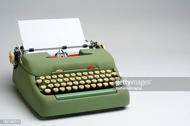 Green Electric Typewriter with Blank Paper