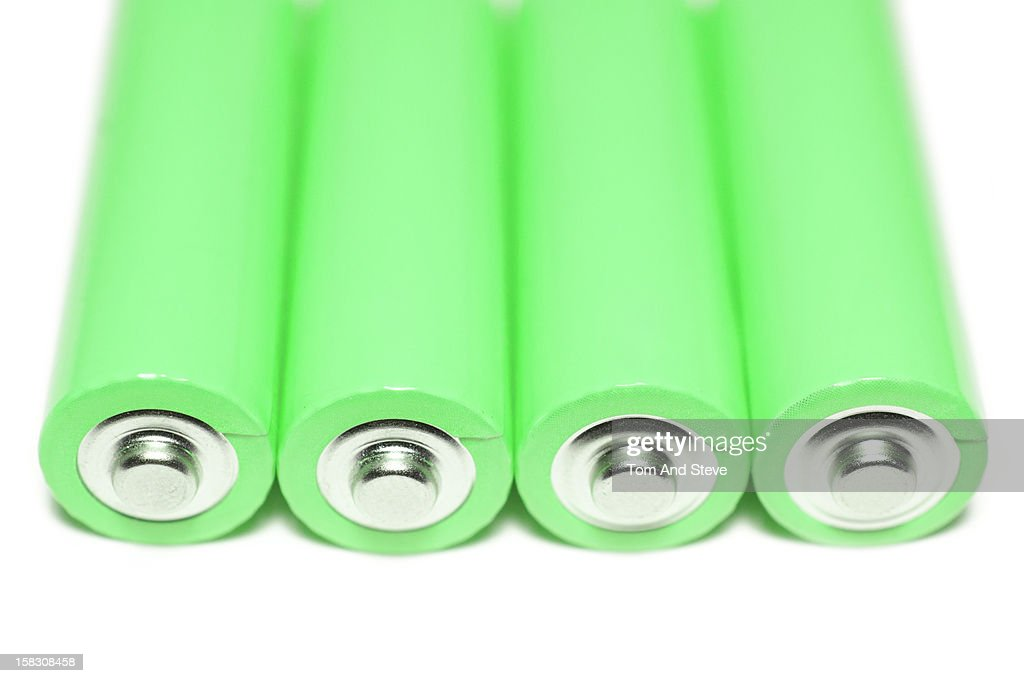 Green energy batteries lying on a white background : Stock Photo