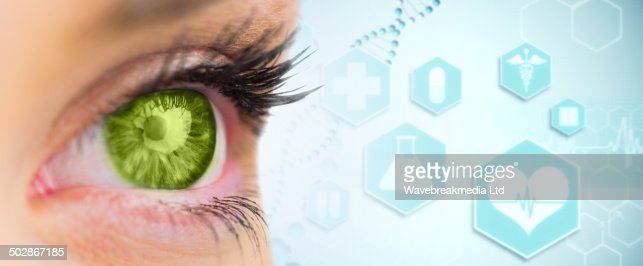 Composite image of green eye looking ahead : Stock-Foto