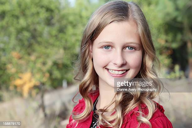 Green eyed blond teen girl wearing red