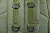 green background of fabric from a backpack with harness