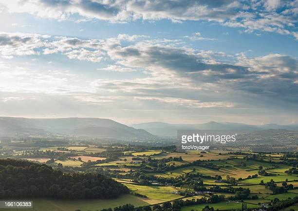 Green fields and misty mountains aerial landscape