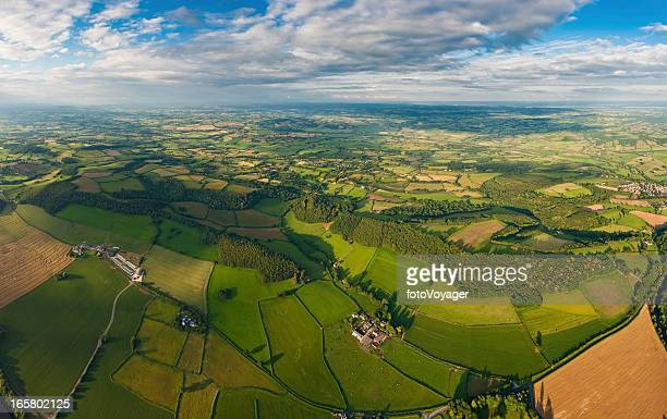 Green fields vibrant patchwork landscape aerial panorama