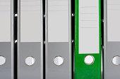Green folder and grey folders