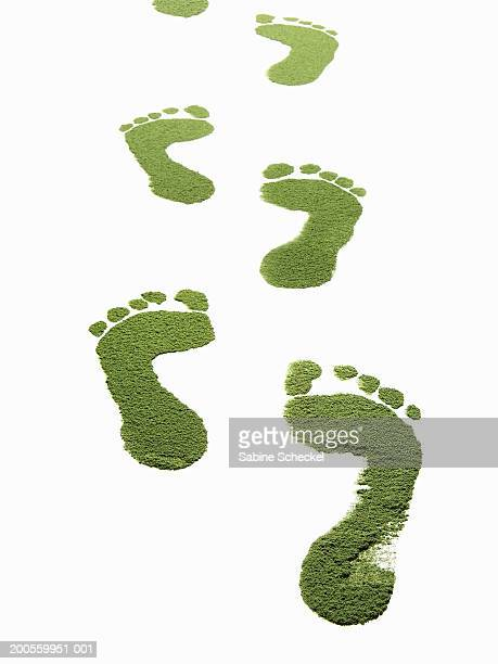 Green foot prints against white background, close-up