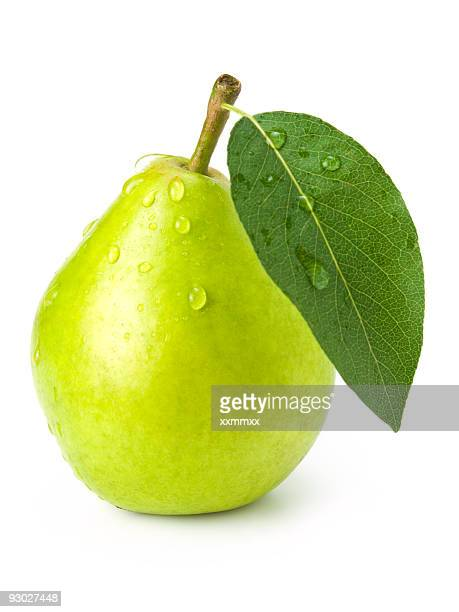 Green fresh pear with leaf and water droplets