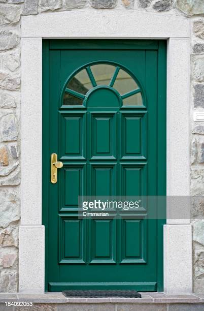 Green front door, isolated without a house