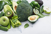 Green fruits and vegetables on white background. Healthy vitamin eating or alkaline diet concept. Copy space