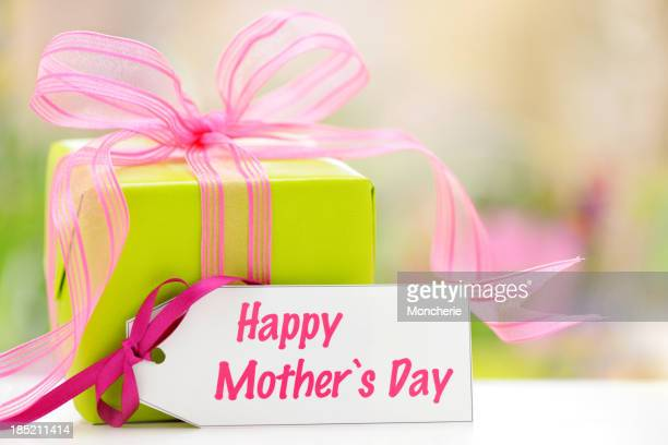 Green gift box with a mothers day card