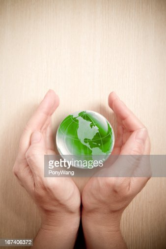 Green glass globe in hand : Stockfoto
