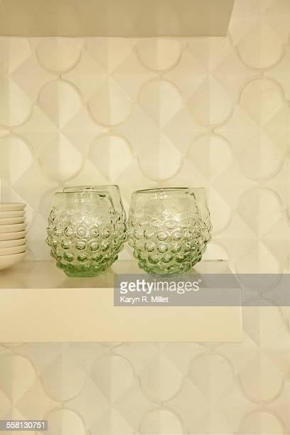Green Glasses on Shelf