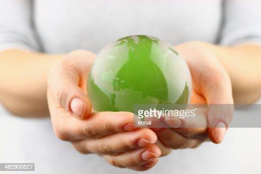 Green globe in the hand