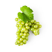 Green grape with leaves isolated on white background clipping path included, design element. Top view, flat lay
