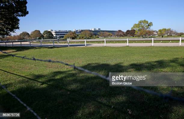 Green grass is pictured near the track at the shuttered Suffolk Downs horse racing track in Boston on Oct 19 2017 Suffolk Downs is the primary...