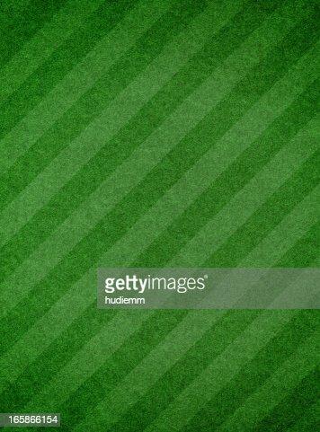Green grass textured background with stripe
