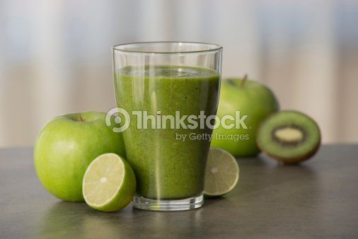 Green healthy smoothie with fruits : Stock Photo