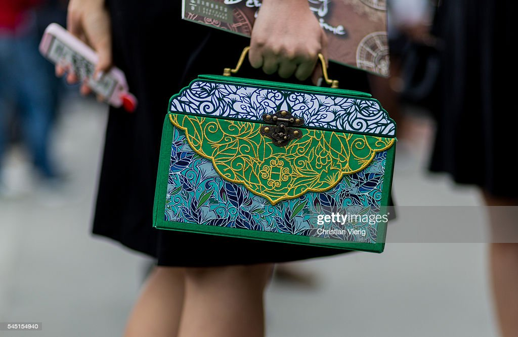 A green Hermes bag outside Chanel during Paris Fashion Week Haute Couture F/W 2016/2017 on July 5 2016 in Paris France