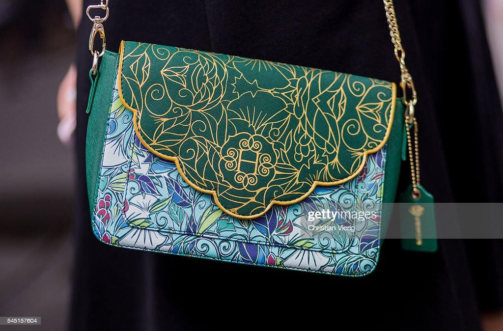 A green Herms bag outside Chanel during Paris Fashion Week Haute Couture F/W 2016/2017 on July 5 2016 in Paris France