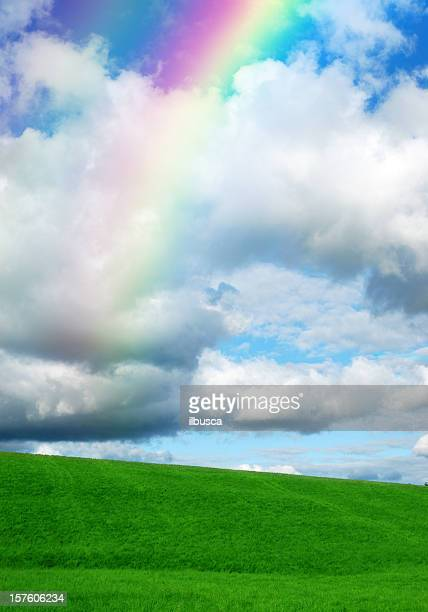 Green hill with rainbow