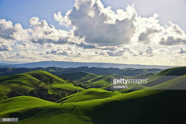 Green hills and cloudy sky view
