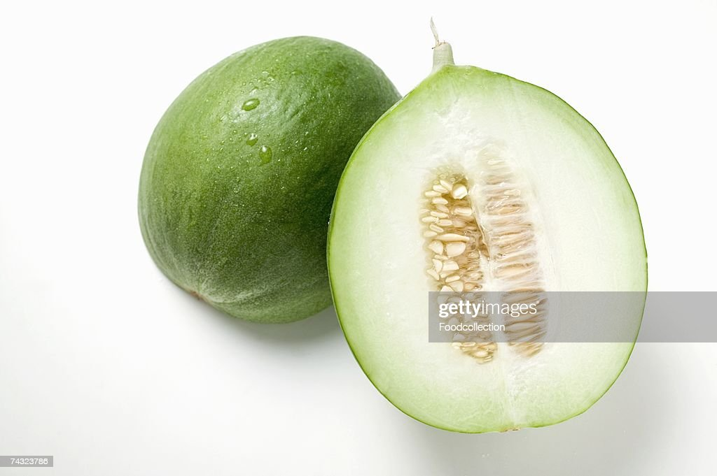 Green honeydew melon, halved