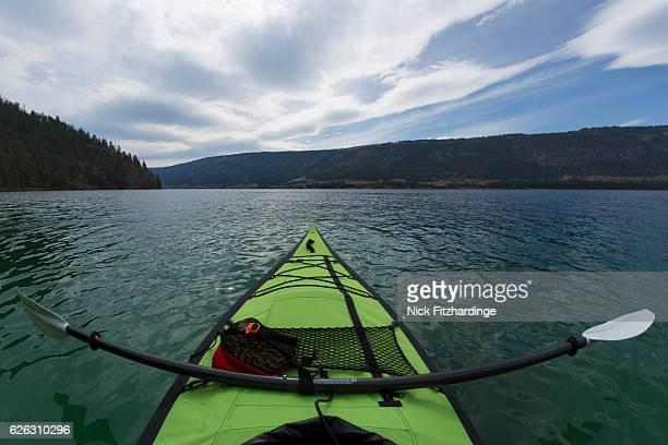 Green inflatable Kayak and paddle, Kalamalka Lake, British Columbia, Canada