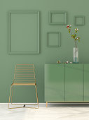 3D illustration. Monochrome interior in green with a golden chair