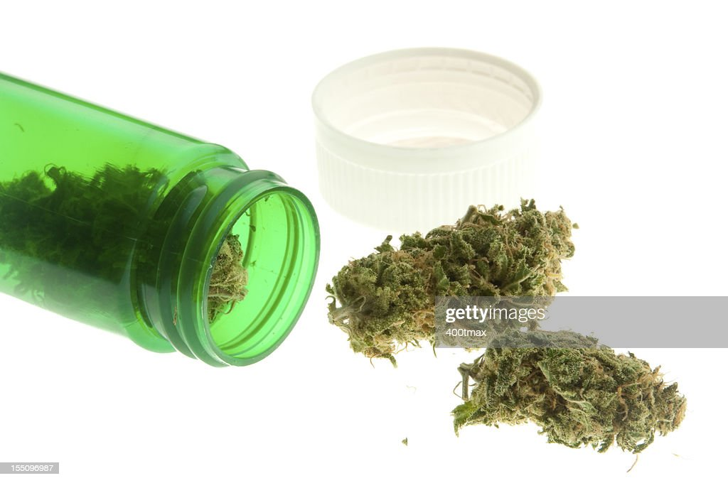 A green jar of marijuana spilled on its side