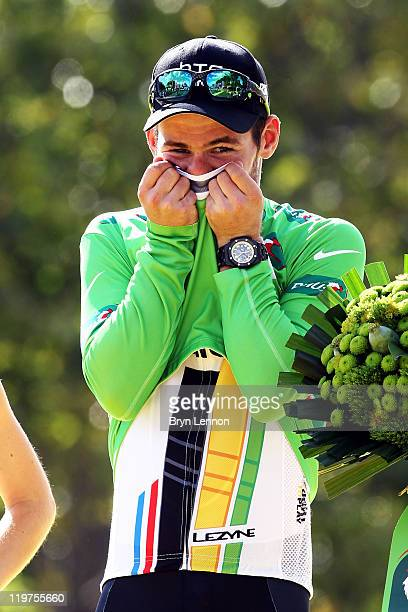 Green Jersey winner Mark Cavendish of team HTC celebrates on the podium after the twenty first and final stage of Le Tour de France 2011 from Creteil...
