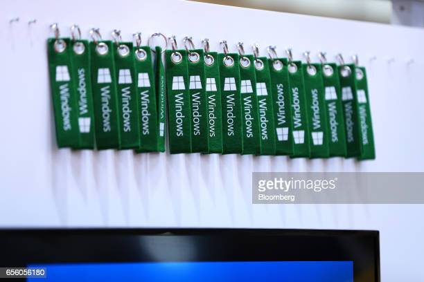 Green key fobs decorated with Microsoft Corp Windows logos hang from a wall at the CeBIT 2017 tech fair in Hannover Germany on Tuesday March 21 2017...