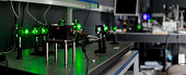 green lasers in the laboratory, laser beams among the optical elements, the study of light and cognitive phenomena