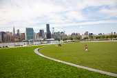 Green lawn, East River and Midtown Manhattan