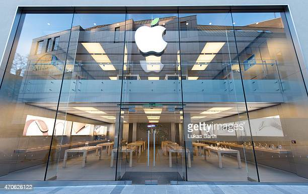 A green leaf adorns the Apple logo on Earth Day at the company's store in Rosenstrasse on April 22 2015 in Munich Germany