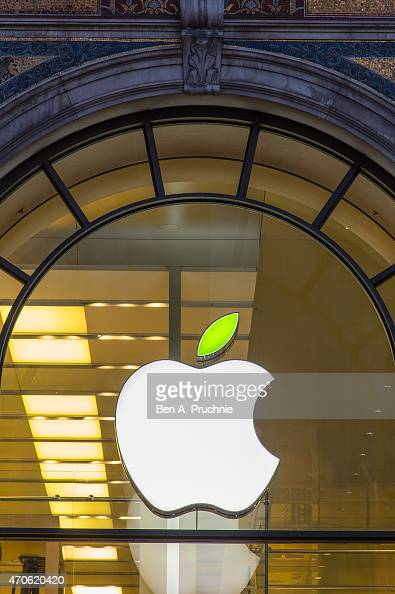 A green leaf is displayed on the Apple logo during 'Earth Day' at the Apple Store Regents Street on April 22 2015 in London England