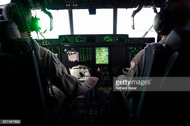 Green light from the HeadUp Display in the cockpit of a Lockheed Martinbuilt C130J Hercules airlifter Externally similar to the classic Hercules in...