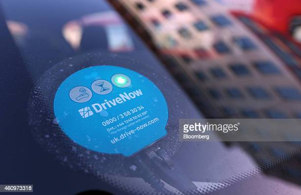 A green light indicates the rental status of a BMW 1 series automobile part of the DriveNow carsharing venture between Bayerische Motoren Werke AG...