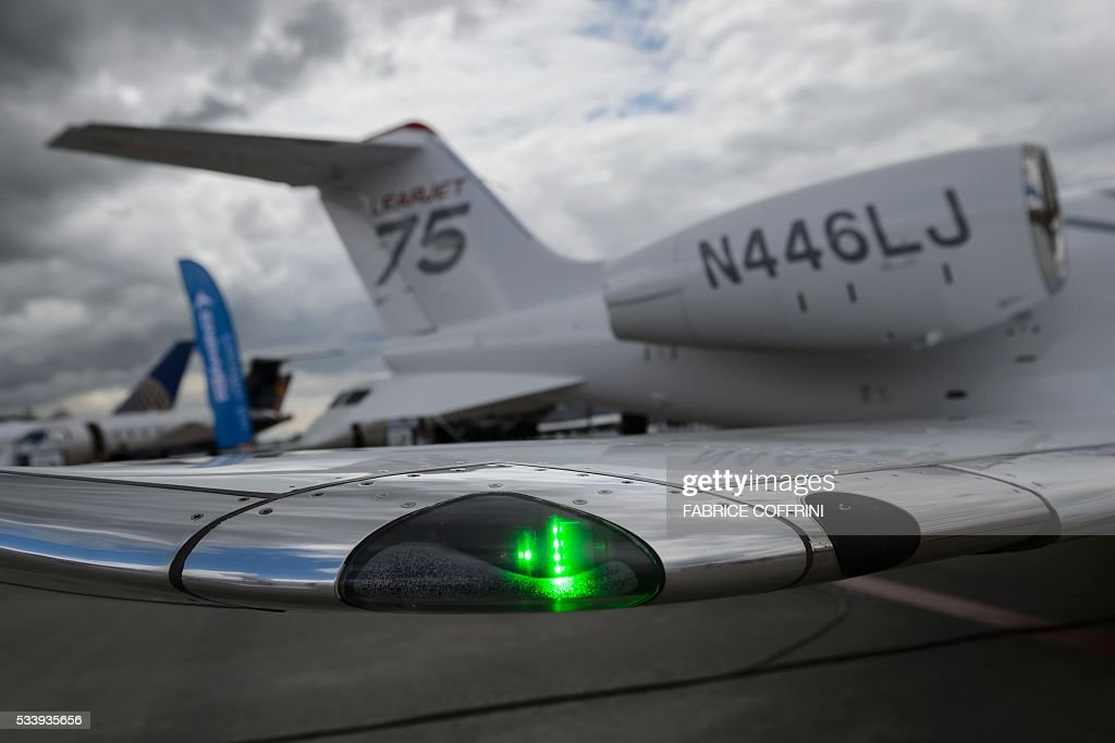 A green light is seen at the manufacturer of business jets Learjet during the European Business Aviation Convention & Exhibition (EBACE) on May 24, 2016 in Geneva. / AFP / FABRICE