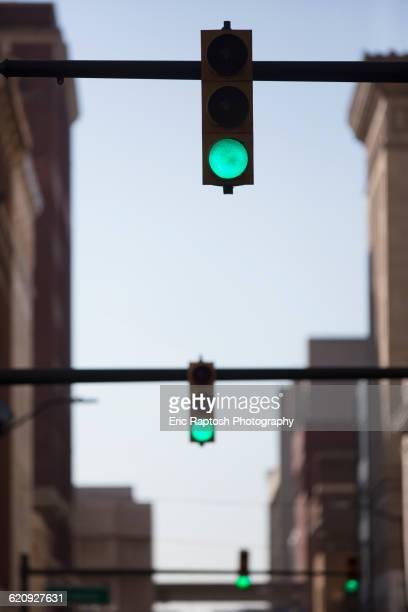 Green lights over city street