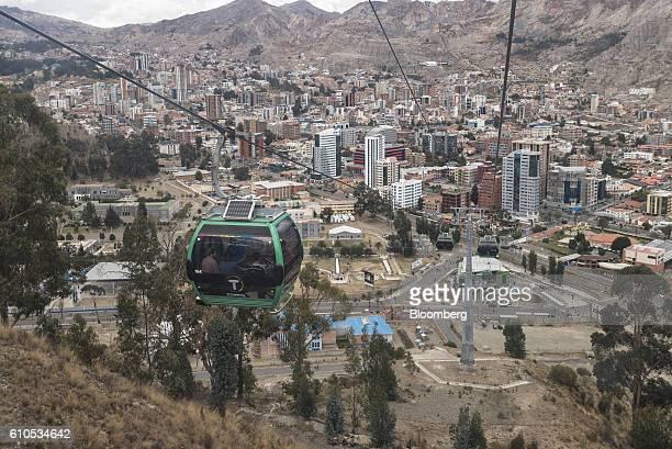A green line Mi Teleferico cable car rides above the South Zone neighborhood of La Paz Bolivia on Sunday Sept 4 2016 Boliva's Mi Teleferico cable...
