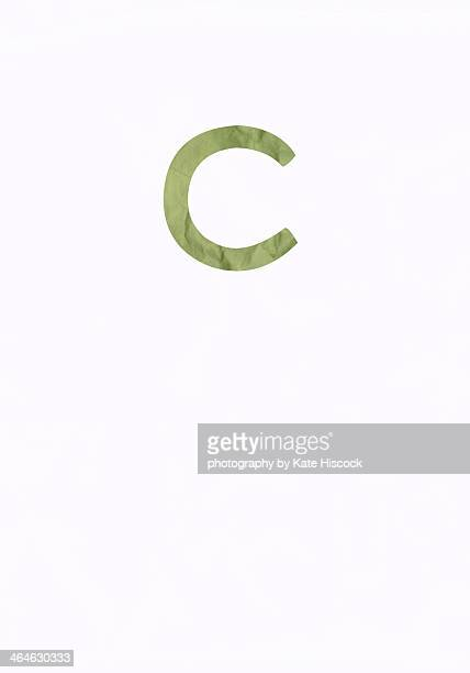 green lowercase letter c - paper cut