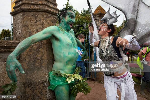 A Green Man battles an Ice Maiden during the final procession at the Green Man festival an independent music festival held annually in a stunning...